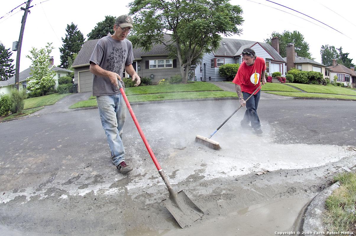 Team Clean - MC on shovel and Tobin on broom